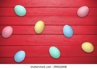 Easter eggs on red wooden planks