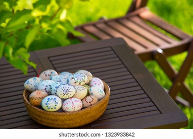 Easter eggs on the table in the garden
