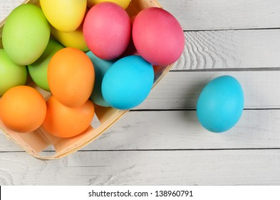Easter eggs on a white wooden plank