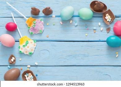 Easter Eggs Over Blue Wooden Background