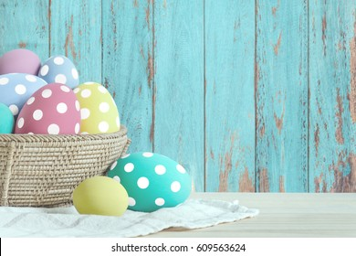 Easter eggs put on wooden in blue wood wall.