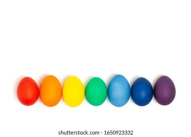 Easter eggs in rainbow colors isolated on the white background. Copy space. Flat lay