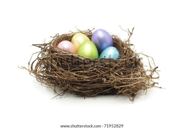Easter eggs in real bird nest on white