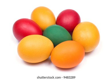 Easter eggs in red, yellow, orange and green color on white background.