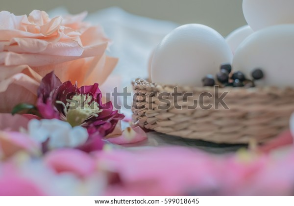 Easter eggs and roses with other flowers on the table