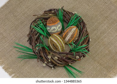 Easter eggs from seeds and cereals in a wicker willow wreath