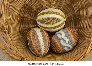 Easter eggs from seeds and cereals in a wicker basket
