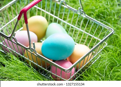 Easter eggs in a shop basket on the grass