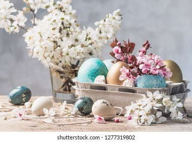 Easter eggs and spring flowers on rustic wooden background.Easter holiday background copy space.