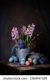 easter eggs and spring flowers on a dark background