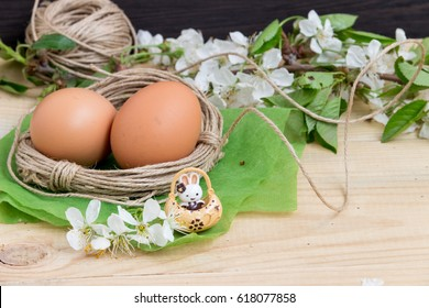Easter eggs and spring flowers on the wooden  background. International celebration concept.