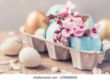 Easter eggs and spring flowers.Easter holiday background copy space.