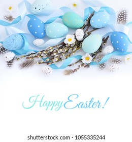 Easter eggs and and willow branches on white background. Easter card with empty space for text