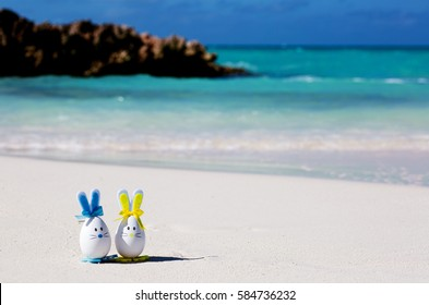 Easter, estereggs on the beach, sand, ocean, sea