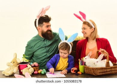 Easter family with color easter eggs on isolated background, space for text. Easter family holding basket with painted eggs.