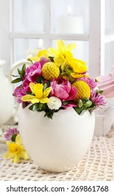 Easter floral arrangement in white egg shell, copy space