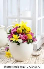 Easter floral arrangement in white egg shell