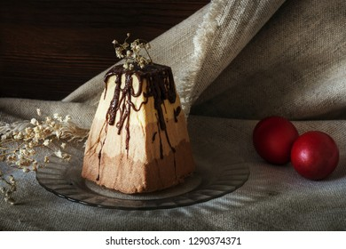 Easter food background. Traditional cottage cheese cake with candied fruits and Easter painted eggs on the festive table. Easter three chocolate