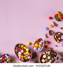 Easter frame with chocolate eggs and sweets on a pink background. Copy space, top view, flat lay
