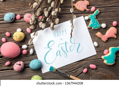 Easter gingerbread cookies on wooden table. Rabbits and eggs. Greeting card. Top view with space for your greetings. - Shutterstock ID 1367944208