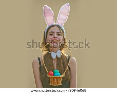 b5891bb6d713d Easter girl with bunny ears and bow on beige background. Easter tradition  and symbol.
