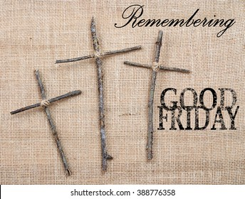 Easter or Good Friday image of three handmade crosses made out of twigs or sticks tied with twine on a rough textured background made of burlap. Text added.