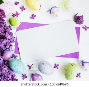Easter greeting card with eggs and lilac flowers