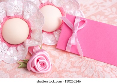 Easter greeting card of eggs and red ribbon over pink background