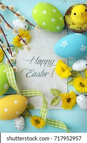 easter greeting card with easter eggs and spring flowers