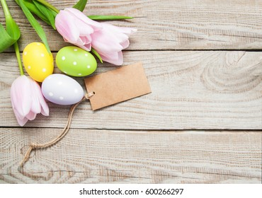 Easter greeting card on a old wooden background