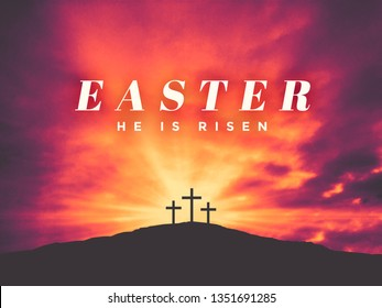 Easter He Is Risen Holiday Text Graphic Design with Three Christian Crosses on Hill of Calvary with Colorful Clouds in Sky and Ray of Light Background