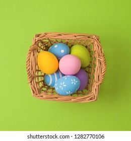 Easter holiday concept with easter eggs in basket decorations. Minimal concept. Top view from above. Flat lay