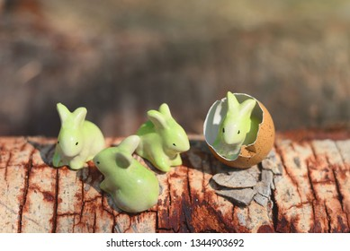 Easter holiday concept with little bunny rabbit ceramic over nature background.