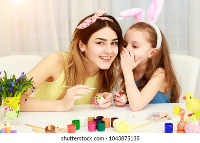 Easter holiday, easter day, Happy family, holiday concept, mother and daughters painting easter eggs. Happy family preparing for Easter. Mom and her girls playing together