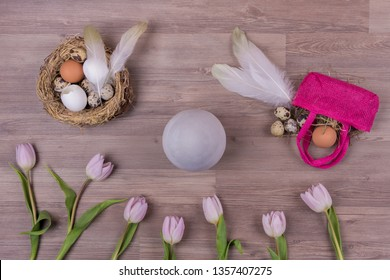 Easter holiday decoration design with eggs feathers bag tulips. Beautiful decoration easternest with egg flowers and basket for traditional celebration in april. Handmade fun tinker luxury bouquet