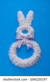 Easter holiday decorations on bright blue background. Minimalist Easter background.