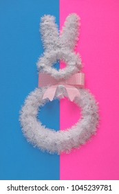 Easter holiday decorations on duo tone blue and pink. Minimalist Easter decor