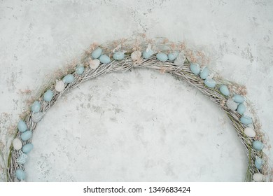 Easter Holiday Egg Wreath Blank Copy Space Layout. Happy Celebration in Elegant Blue Pastel Decor. Traditional Empty Horizontal Shabby Wall Flat Lay Detail. Decorative Floral Rustic Background
