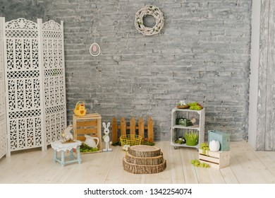 Easter Holiday Interior Decoration Background. Happy Celebration in Elegant Spring Studio Decor. Seasonal Flower Style Room. Empty Horizontal Brick Wall Copy Space Wreath. Decorative Wooden Rabbit
