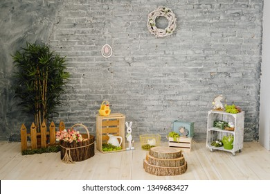 Easter Holiday Interior Decoration Room Background. Happy Celebration in Elegant Spring Studio Room Decor. Tulip Flower Style. Empty Horizontal Brick Wall with Copy Space Wreath and Wooden Rabbit