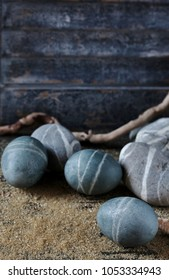 Easter holiday in a nautical style. Easter eggs painted tea Hibiscus gray, tied with a rope, get light streaks. and the result is an egg like pebbles stones. eggs Still as stones and natural stones.