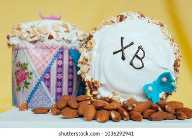 Easter holiday. Traditional orthodox christian easter cake and almonds on yellow background