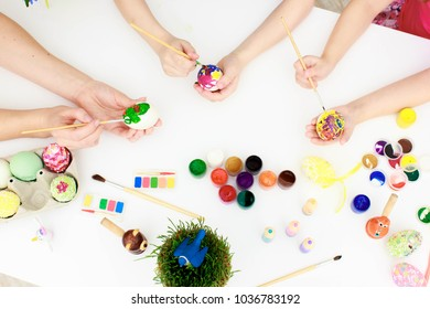 Easter holiday,happy hamily - a mother and her daughters -painting Easter eggs. Happy family preparing for Easter. Happy easter