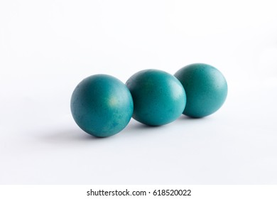 easter, holidays, tradition, style and minimalism concept - Row of ombre blue Easter eggs isolated on white background