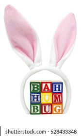 Easter...Bah Humbug. Toy blocks with pink bunny ears. Vertical.