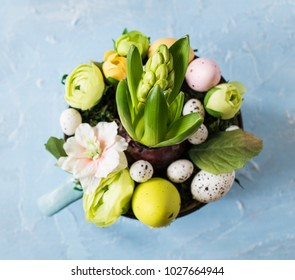Easter hyacinth comrosition with eggs and flowers in a mug close up.