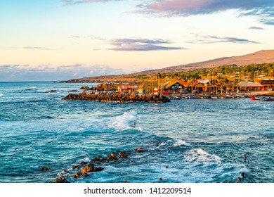 EASTER ISLAND, CHILE - FEBRUARY 11, 2016 : View of fisherman port of Hanga Roa Village on Rapa Nui or Easter Island in Chile in the evening