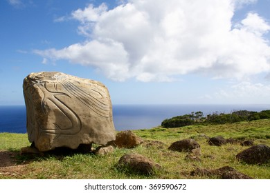 Easter Island symbols carved into a stone atop of a cliff, Chile