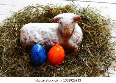 easter lamb in straw and easter eggs