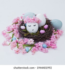 easter nest of beautiful pink hyacinth flowers with a chicken eggs on a white backgrorund. Easter composition. Square frame. Free space for text